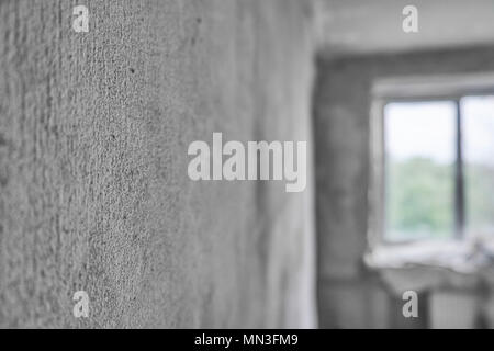Concrete wall in front of a window. Overhaul concept. Apartment repairs. Home remodeling - Stock Photo