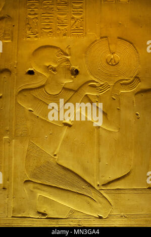 Egypt. Abydos. Temple of Seti I. New Kingdom. 19th Dynasty. The Pharaoh making an offering of a gold necklace. 1292-1189 BC. - Stock Photo