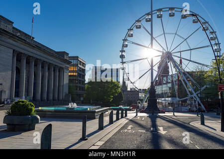 Sheffield City Hall and a temporary observation wheel on a sunny day in May, with completely blue skies and no clouds. Sheffield, South Yorkshire, UK. - Stock Photo