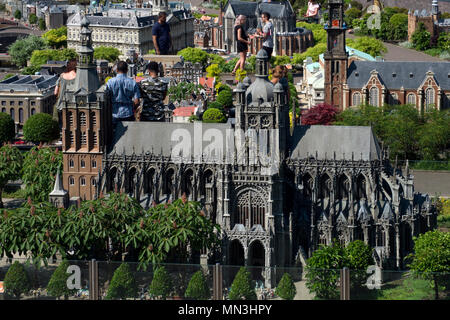 Tourists visit the Madurodam theme park, in the city of The Hague. This park has a collection of miniatures of the most important monuments of Holland - Stock Photo