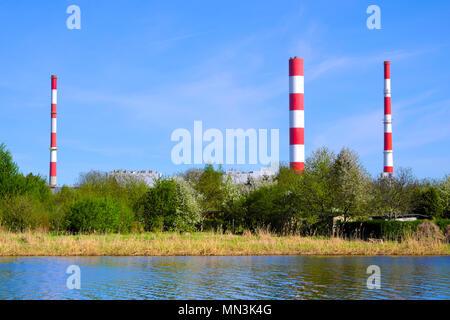 Warsaw, Mazovia / Poland - 2018/04/12: Siekierki Power and Heat Plant in Czerniakow quarter of Warsaw neighboring Czerniakowskie Lake nature reserve - Stock Photo