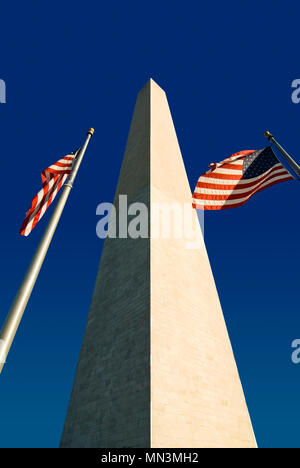 The Washington Monument  with two American flags. Located in Washington DC along the National Mall. - Stock Photo