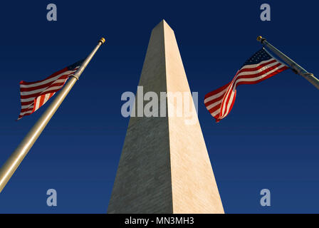 The Washington Monument  flanked by two American flags. Located in Washington DC along the National Mall. - Stock Photo