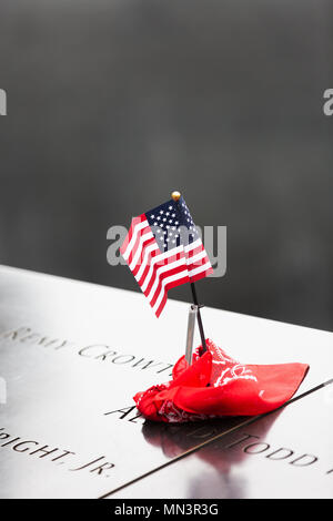 September 11 2001 memorial, names  and the american flag; 9/11 Memorial pools, downtown New York city, USA. See also image MN3R4C - Stock Photo