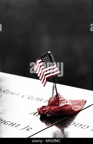 September 11 2001 memorial, names  and the american flag; 9/11 Memorial pools, downtown New York city, USA see also image MN3R3G - Stock Photo