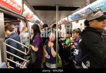 New York subway passengers in a crowded train carriage on the New York city subway, New York, USA - Stock Photo
