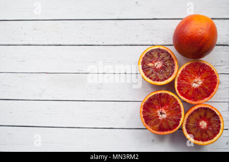 Blood orange on white table. - Stock Photo