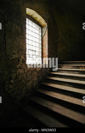 Wooden stairs of a destroyed staircase of an old tenement house in Poznan - Stock Photo