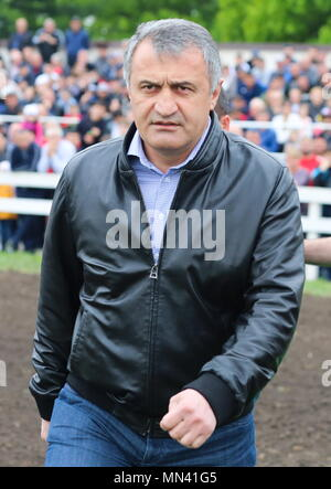 Beslan, Russia. 13th May, 2018. BESLAN, RUSSIA - MAY 13, 2018: South Ossetia's President Anatoly Bibilov attends horse races marking the 73rd anniversary of the victory over Nazi Germany in the Great Patriotic War of 1941-1945, the Eastern Front of World War II, at a hippodrome of the Beslan Stud Farm. Yelena Afonina/TASS Credit: ITAR-TASS News Agency/Alamy Live News - Stock Photo