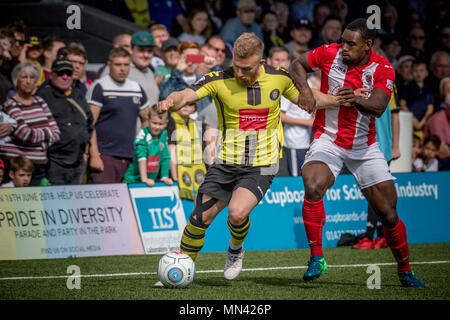 Harrogate, Yorkshire, UK. 13th May, 2018. News: Harrogate Town Promoted to the National League, The CNG Stadium, Harrogate North Yorkshire, UK. 13 May 2018.   George Thomson (Harrogate Town) holds off the Brackley Town player to set up another attack.  Harrogate Town 3-0 Brackley Town - National League North playoff final at the CNG Stadium in Harrogate. Harrogate are promoted to the National League for the 2018/19 season. Credit: Caught Light Photography Limited/Alamy Live News - Stock Photo