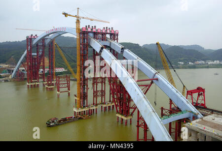 (180514) -- LIUZHOU, May 14, 2018 (Xinhua) -- Aerial photo taken on May 14, 2018 shows the Liuzhou Guantang Bridge in south China's Guangxi Zhuang Autonomous Region. The middle bridge arch, weighing 5,885 metric tons, was successfully hoisted to its installation position on Monday. (Xinhua/Li Hanchi) (zyd) - Stock Photo