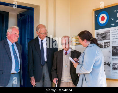 Drem, Scotland, 14 May 2018. Celebrating RAF Drem centenary, Scotland, UK. A plaque unveiled to mark the 100th anniversary. It played an important role in World War II, with  43rd Squadron stationed here. Gordon Mills, aged 96, who was stationed here during World War II unveiled the information board. The airfield is famed for inventing the Drem lighting system, aiding spitfires to land at night, which was adopted by all RAF stations. Remaining buildings are now Fenton Barns retail village. The war veteran being interviewed by the local paper, the East Lothian Courier - Stock Photo