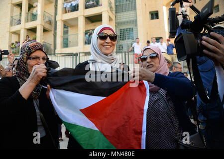 Jerusalem, Israel. 14th May, 2018. JERUSALEM, ISRAEL - MAY 14, 2018: Palestinians rally against the US Embassy opening in Jerusalem, Israel; protests mark as well the 70th anniversary of the Israeli Declaration of Independence. Sergey Orlov/TASS Credit: ITAR-TASS News Agency/Alamy Live News - Stock Photo