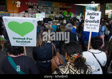 London, UK. 14th May, 2018. Members of the Grenfell community listen to speeches under the Westway flyover at Latimer Road at the end of the Grenfell Silent March. The march, which takes place on the monthly anniversary of the fire on 14th June 2017, has now returned to the original route starting at the Notting Hill Methodist Church. 71 people died in the Grenfell Tower fire and over 70 were injured. Credit: Mark Kerrison/Alamy Live News - Stock Photo
