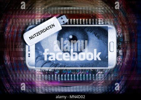 Mobile Phone with facebook logo and USB stick with the inscription user data, Facebook Data Scandal Photo icon, Handy mit Facebook-Schriftzug und USB- - Stock Photo
