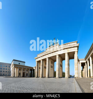 Brandenburg Gate (Brandenburger Tor) in Berlin, Germany, on a bright day with blue sky behind, text space - Stock Photo