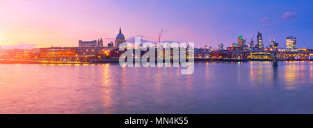Millennium Bridge leading to Saint Paul's Cathedral in central London, England, on a sunset - Stock Photo