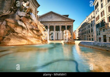 Fountain on Piazza della Rotonda with Parthenon behind on a bright morning in Rome, Italy - Stock Photo