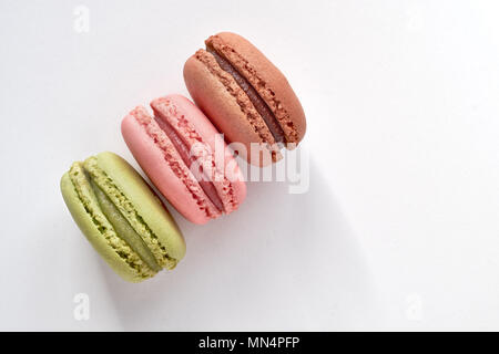 Sweet and colourful french macaroons or macarons on light gray background, text space - Stock Photo