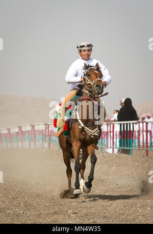 Ibri, Oman, 28th April 2018: omani men at a traditional horse race event where young riders show their skills - Stock Photo