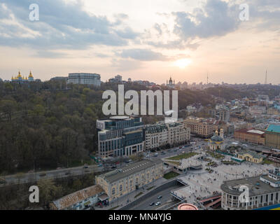 view of St. Andrew's Church and the St. Michael's Monastery of the Golden Domes, the Ministry of the Interior and the Postal Square in Kyiv city - Stock Photo