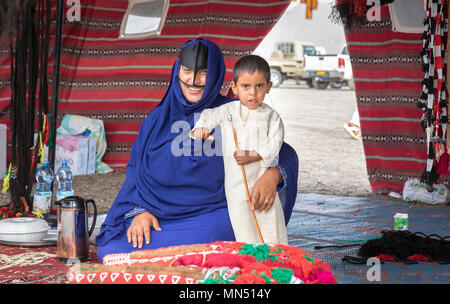 Ibri, Oman, 28th April 2018: bedouin woman with her kid in a tent - Stock Photo