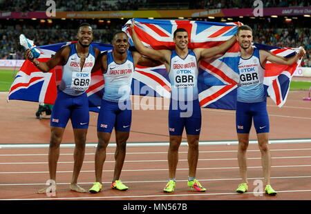 LONDON, ENGLAND - AUGUST 12: Chijindu Ujah, Adam Gemili, Daniel Talbot and Nethaneel Mitchell-Blake of Great Britain celebrate winning gold in the Men's 4x100 Relay final during day nine of the 16th IAAF World Athletics Championships London 2017 at The London Stadium on August 12, 2017 in London, United Kingdom. - Stock Photo