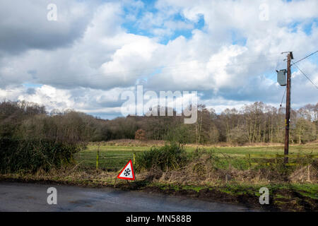 Ice on road warning sign in rural Cheshire UK - Stock Photo