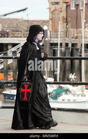 Girl Goth with coffin handbag - Stock Photo