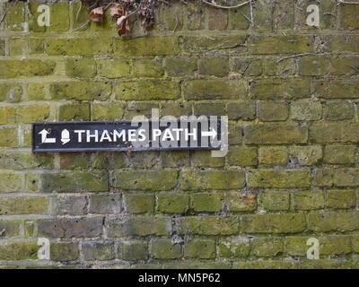 Thames Path Black Metal Sign on a Brick Wall in Twickenham London - Stock Photo