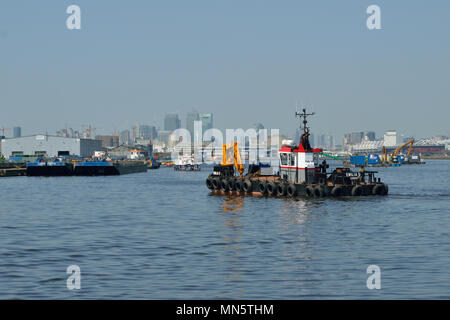 Boats and barges in the King George V Dock in London's Royal Docks working on the London City Airport Development Programme (CADP) construction site - Stock Photo
