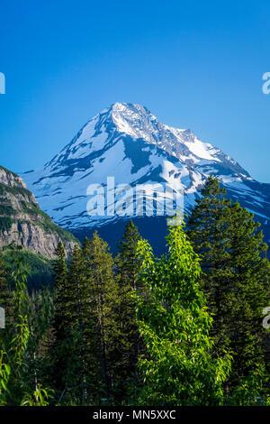 Alpine scenery with snow covered Mount Jackson near St. Mary Lake in Glacier National Park, Montana, USA. - Stock Photo