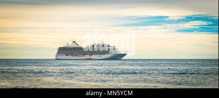 Side view of cruise ship. Luxury passenger vessel sails on the ocean. Cruise travel vacation concept. - Stock Photo
