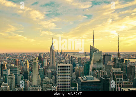New York City skyline at sunset with vintage filter - Stock Photo
