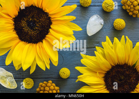 Yellow Flowers and Citrine on Blue Table including Sunflowers, Craspedia and Clustered Everything - Stock Photo
