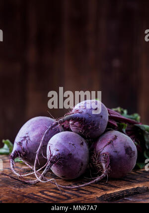 Raw beetroot bunch on a wooden surface - Stock Photo