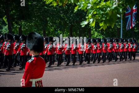 LONDON - JUNE 17, 2017: Queens guard in traditional red coats and bear fur busby hats march in formation on the Mall in a Trooping the Colour parade - Stock Photo