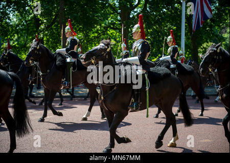 LONDON - JUNE 17, 2017: Royal guards of the Household Calvary on horseback dressed in ceremonial uniform pass down the Mall. - Stock Photo
