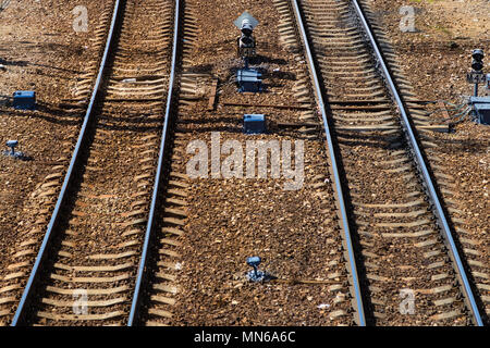 Top view of a railway track on a sunny day. Steel rails. Crushed stone. Concrete sleepers. Traffic light. Automation systems - Stock Photo