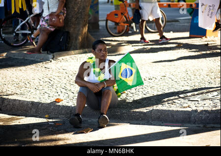 Rio de Janeiro - April 17, 2016: Peaceful demonstration against corruption in Brazil and the government of Dilma Rousseff took over Copacabana beach - Stock Photo