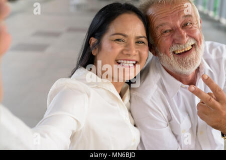 Mature multi-ethnic couple happy and in love while exploring the - Stock Photo