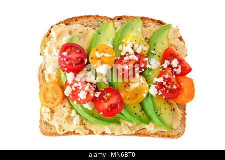Avocado toast with hummus and tomatoes isolated on a white background - Stock Photo