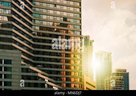View of modern hotel lined with glass as contemporary residential high-rise buildings on background in Tel Aviv, Israel. - Stock Photo