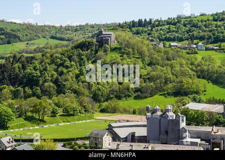 Elevated view of Murat and Church of Saint-Pierre of Bredons, commune in the Cantal department in the Auvergne region in south-central France. - Stock Photo