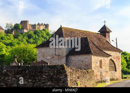 France, Lot, Quercy, Dordogne Valley, Prudhomat, Notre Dame de Felines chapel and Chateau de Castelnau Bretenoux in the background // France, Lot (46) - Stock Photo