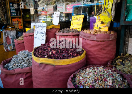 Spices and herbs displayed on bags in old Amman - Stock Photo