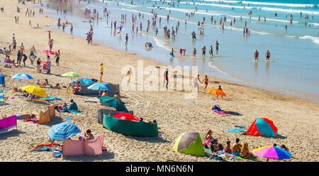 BALEAL, PORTUGAL - JUL 30, 2017: People at the ocean beach in a high peak season. Portugal famous tourist destination for it's ocean beaches. - Stock Photo