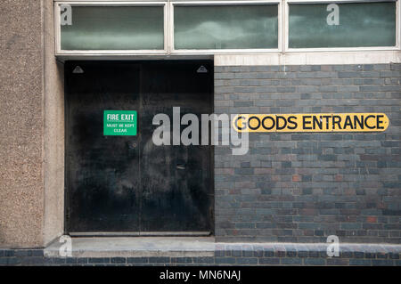Goods entrance at the rear of a shop. - Stock Photo