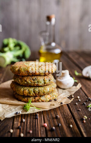 Fried vegetarian broccoli burgers with mushrooms and garlic - Stock Photo
