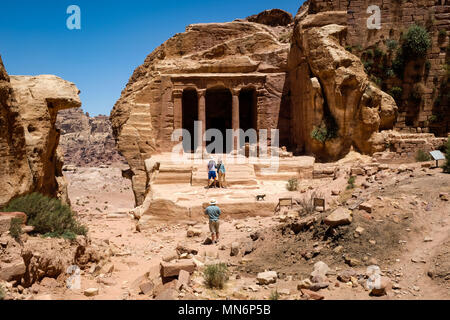 Tourists take a picture at Garden Hall in the ancient Nabatean city - Stock Photo